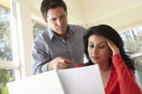 Couple reviewing energy bills